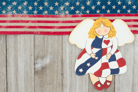 USA patriotic old flag and an angel on a weathered wood  with copy space for your message