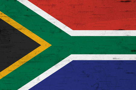 A rustic old South Africa flag on weathered wood for a background Imagens