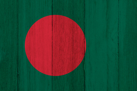 A rustic old Bangladesh flag on weathered wood for a background
