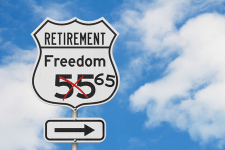 Retirement with Freedom 65 plan route on a USA highway road sign with sky Stock Photo