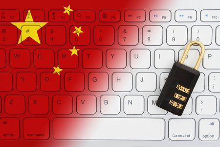 Chinese flag keyboard with a combination lock for internet security 免版税图像