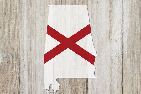 Map of Alabama in the Alabama flag colors on weathered wood