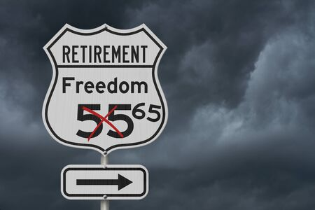 Retirement with Freedom 65 plan route on a USA highway road sign with stormy sky Stock Photo