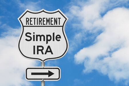 Retirement with Simple IRA plan route on a USA highway road sign with sky background