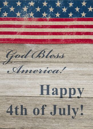 USA Independence greeting USA patriotic old flag on a weathered wood background with text God Bless America Happy 4th of July