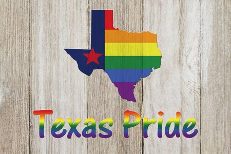 A rustic old Texas pride flag with state map on weathered wood for a background Stock Photo