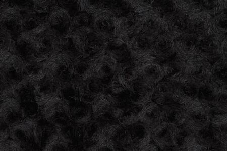 Black rose textured plush fabric  with muted mix of shades to provide copy-space for your message
