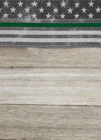 American thin green line flag over weathered wood background with copy space for your message Stock Photo