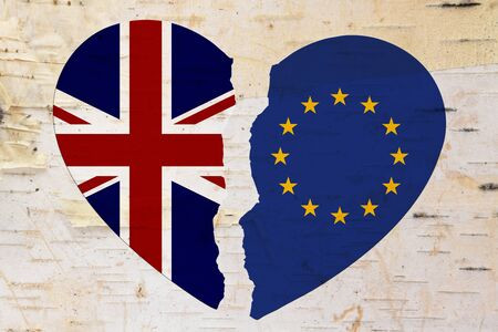 British and EU flags in a broken heart brexit over weathered wood