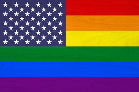 A USA pride flag on with wood texture for a background