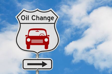 Oil change with car route 66 USA highway road sign with sky background