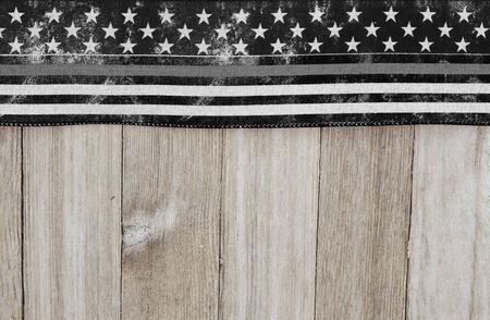 American thin gray line flag over weathered wood background with copy space for your message