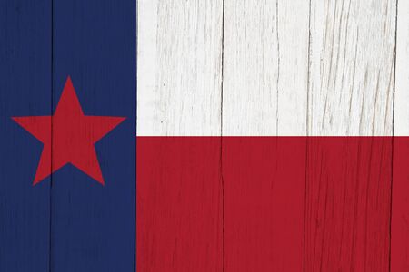 Texas state flag red white and blue with star on weathered wood