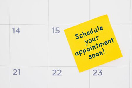 Schedule you appointment soon message yellow sticky note on a calendarv 스톡 콘텐츠