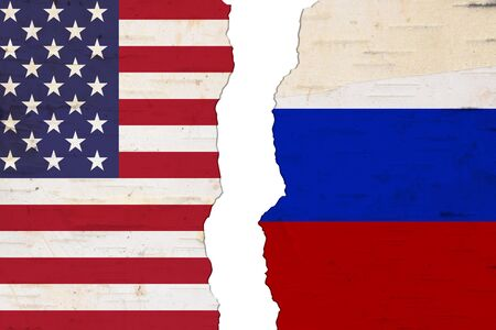 American and Russian flags that are torn apart showing the bad relationship between the two countries