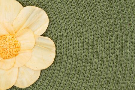 Olive green textured concentric circle fabric material with flower background with copy space for your message