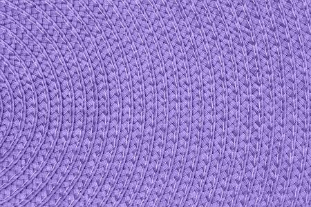 Materiale in tessuto a cerchi concentrici con texture viola brillante per uno sfondo o una trama per le tue immagini o testo