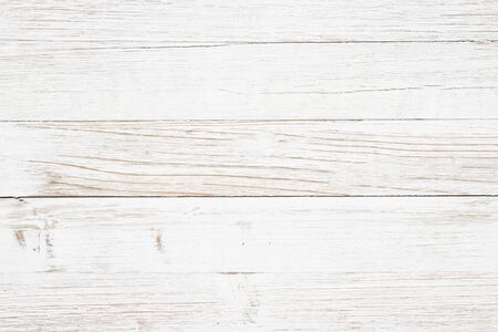 Weathered whitewash wood textured background with copy space for your message