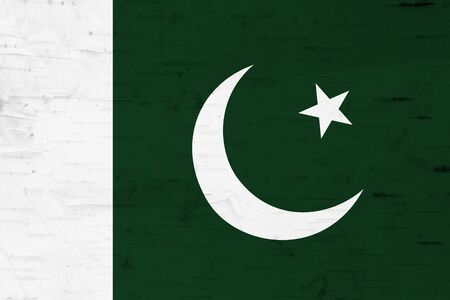A rustic old Pakistan flag on weathered wood for a background