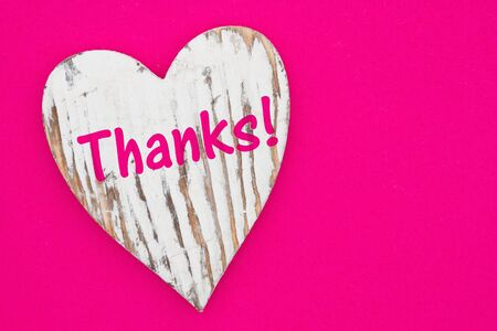 Thanks message on weathered heart on bright pink textured felt material
