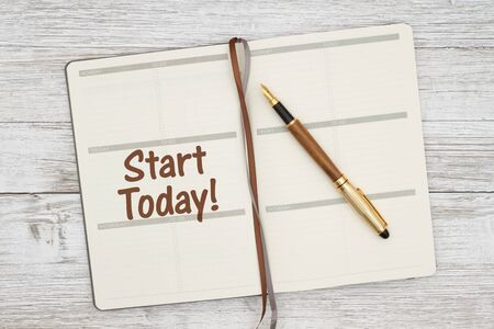 Start today making your plans with day planner and pen on a weathered whitewash wood
