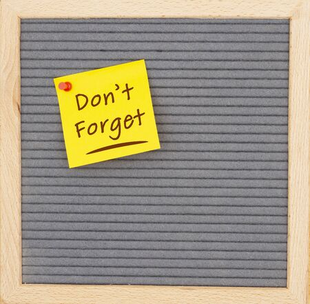 Dont Forget message on sticky note on gray felt letter board with a wood frame