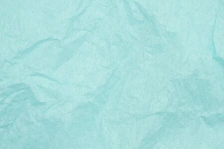 Teal textured wrinkled paper material for a background or texture for your images or text
