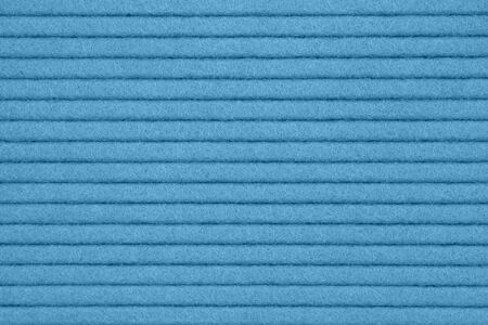 Blue textured grooved lines felt fabric material for a background or texture for your images or text