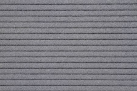 Gray textured grooved lines felt fabric material for a background or texture for your images or text Stock Photo