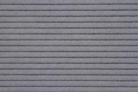 Linee scanalate strutturate grigie feltro materiale in tessuto per uno sfondo o una trama per le tue immagini o testo
