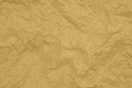 Gold textured wrinkled paper material for a background or texture for your images or text