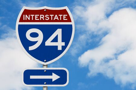 I-94 interstate USA red and blue highway road sign with sky