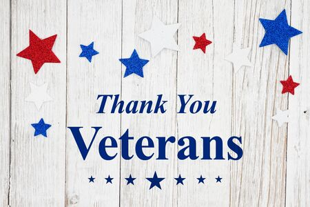Veterans Day thank you message with red, white and blue stars on a weathered whitewash wood Stock fotó