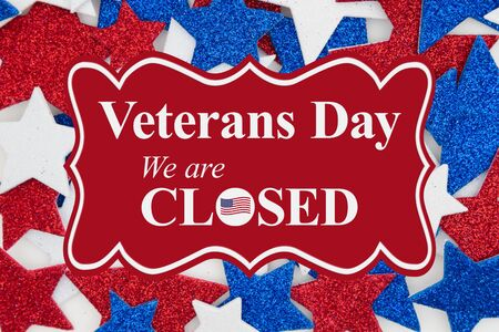 Veterans Day closed sign message with red, white and blue glitter stars