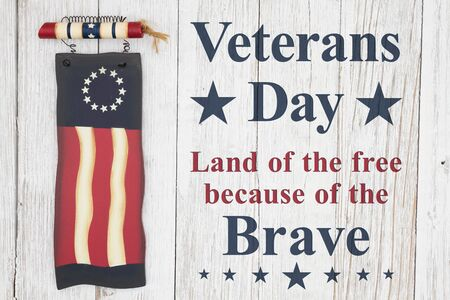 Veterans Day thank land of the free message with old retro wood flag on a weathered whitewash wood