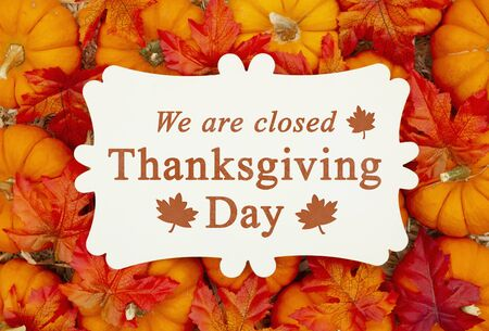 We are Closed Thanksgiving Day sign on a metal sign on pumpkins and a straw hay