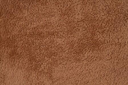 Material de tela de felpa con textura marrón Foto de archivo
