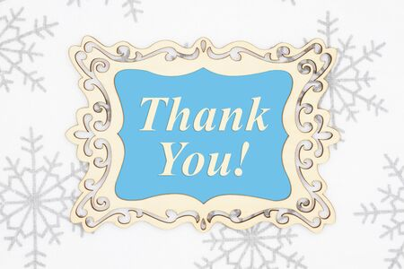 Thank you message in a wood frame with white and gray snowflake