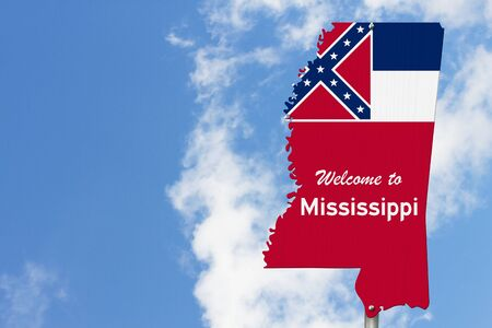 Welcome to the state of Mississippi road sign in the shape of the state map with the flag with sky background