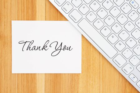 Thank you greeting card with a keyboard on a wooden desk Stock fotó - 138293084