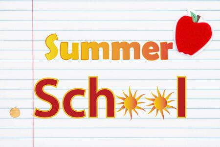 Summer School words with a red apple and keyboard icon on lined paper Stok Fotoğraf