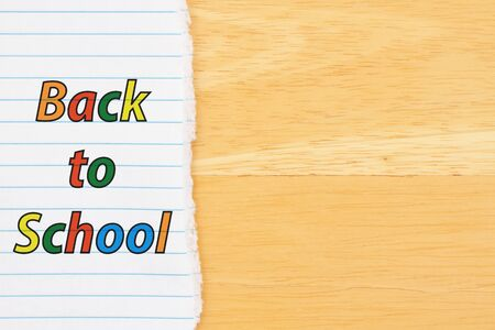 Back to School background with lined paper on a desk with copy space for your school or education message