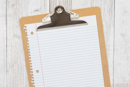 Clipboard with blank paper on weathered whitewash wood background mockup with copy space for your application or checklist list message