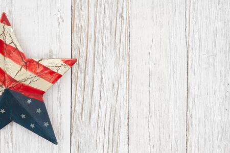 Retro USA star on weathered whitewash wood background with copy space for your American message