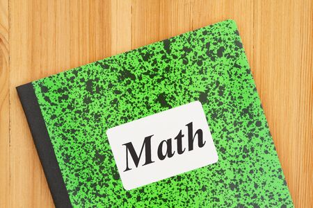 Retro Math green and black composition notebook on a wood desk