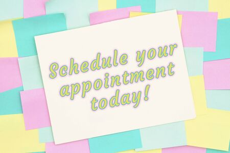 Schedule your appointment today type message on card on a bunch of multi-color sticky notes