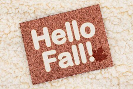Hello Fall brown glitter greeting card on beige plush fabric Banco de Imagens - 150067158