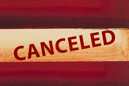 Canceled type message on red and white grunge textured wood material 版權商用圖片