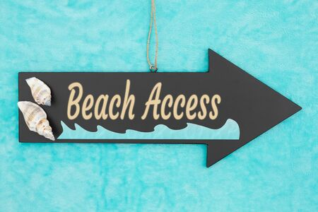 Beach Access hanging arrow chalkboard sign with seashells and ocean water