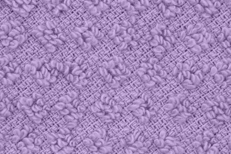 Purple knit textured weave material background with copy space for message or use as a texture
